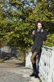 On the bridge in autumn park Stock Photo