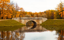 Bridge in autumn park Stock Photography