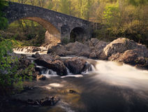 Bridge of Balgie, glen Lyon, Perthshire. The ancient, Bridge of Balgie, over the river Lyon, in Glen Lyon, in Perthshire, Scotland. In heavy rainfall or snow Stock Photo