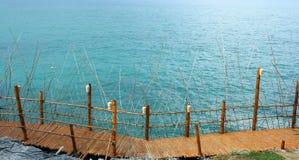 Bridge bamboo. On sea background Stock Photo