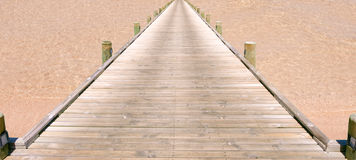 A bridge on the beach Royalty Free Stock Image