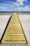 Bridge on beach Stock Image