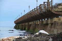 Bridge on the beach promenade of navia spain Royalty Free Stock Photo