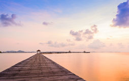 Bridge on beach in sunrise and sea wave Royalty Free Stock Images