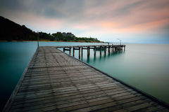 Bridge on the beach at sunrise Stock Photo