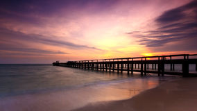 Bridge on beach in Sunset Royalty Free Stock Photos