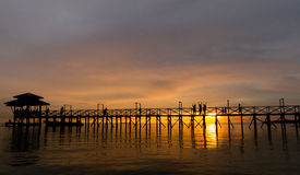 Bridge on beach in sunset Royalty Free Stock Photo