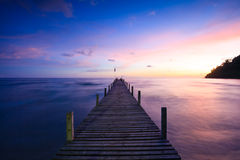 Bridge on beach in sunset and sea wave. In Koh Kood , Thailand Royalty Free Stock Photography