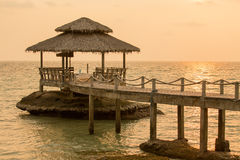 Bridge on beach in sunset and sea wave in Koh Kood , Thailand Royalty Free Stock Images