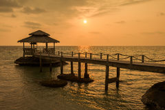 Bridge on beach in sunset and sea wave in Koh Kood , Thailand Royalty Free Stock Photo