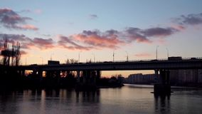Bridge with a beautiful cloudy sunset in the background. Bridge in Russia with a beautiful cloudy sunset in the background stock video footage