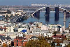 The bridge, which is being repaired, is on the other side of the city. Trees and architecture.Podol, Kiev. Ukraine. stock photo