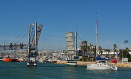 Bridge being lifted for yacht to pass under Royalty Free Stock Photo