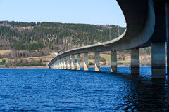 Bridge bend over big lake in Norway Royalty Free Stock Images