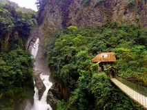 Bridge beyond. Waterfall nature ecuador baños jungle river tropical landscape Stock Image