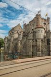 Bridge and bike in front of Gravensteen Castle on cloudy day in Ghent. Stock Images