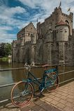 Bridge and bike in front of Gravensteen Castle on cloudy day in Ghent. Royalty Free Stock Photos