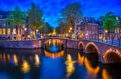 Bridge Blue hour arch over canal. In Amsterdam Netherlands. Famous landmark old town evening traditional Dutch architecture Stock Photography