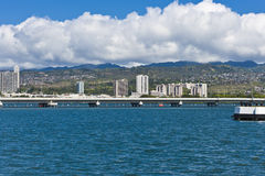 Bridge on blue water Stock Images