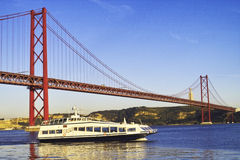 Bridge and boat. In Lisbon Stock Photo