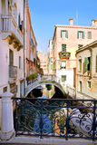 Bridge, boats and colorful houses in Venice Stock Images
