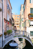 Bridge, boats and colorful houses in Venice Royalty Free Stock Photography
