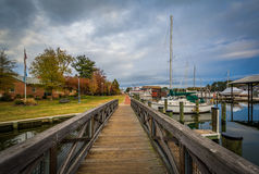 Bridge and boats docked in the harbor, in St. Michaels, Maryland Royalty Free Stock Image