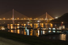 Bridge and boats at night Stock Images