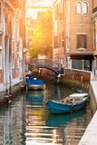 Bridge and boats in Venice. Bridge over a Venetian Canal and boats. Reflections are on the water Stock Images