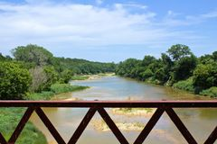 From a Bridge on the Brazos. This shot was taken from an rustic metal bridge over the Brazos River in the spring in Texas Stock Image
