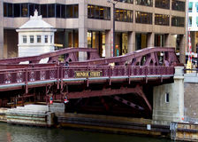 Monroe Street Bridge and bridge house over Chicago River during rush hour. Commuters rush over the Monroe Street bridge crossing the Chicago River, which is seen stock photo