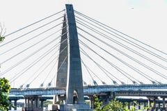 Bridge Bridge over the sea Modern bridge Access to the sea Sunny day Cars Tour Sea Architecture Modern structure. Bridge Stock Images