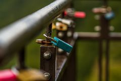 Bridge with locks. Bridge brush full of locks. The first lock is sharp, but the rest is blurry Stock Photo