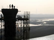 Bridge Builders. Workers on a pier in a river in southern Taiwan Stock Photo