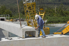 Bridge builders. Builders construct a concrete bridge over a small river in Westland, New Zealand Stock Photography