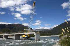 Bridge builders. GREYMOUTH, NEW ZEALAND, DECEMBER 2013: Builders construct a concrete bridge over a small river in Westland, New Zealand Stock Images