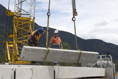 Bridge builders. Builders unload modules for a concrete bridge over a small river in Westland, New Zealand Stock Photography