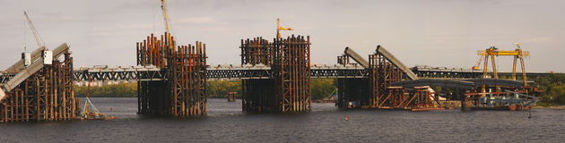 Bridge building panorama. Building a bridge over the Dnipro river in Kiev, Ukraine Royalty Free Stock Photography
