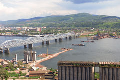 Bridge building through Yenisei Royalty Free Stock Photography