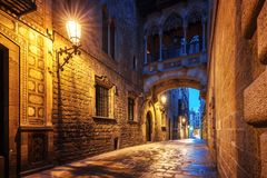 Bridge between buildings in Barri Gotic quarter of Barcelona Royalty Free Stock Photo