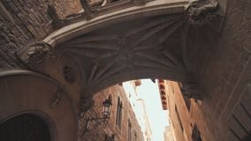 Bridge between buildings in Barri Gotic quarter of Barcelona, Spain. Old streets of Barrio Gotico in Barcelona. Catalonia. It is centre of old city of stock video