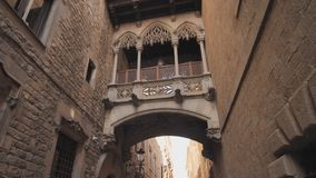Bridge between buildings in Barri Gotic quarter of Barcelona, Spain. Old streets of Barrio Gotico in Barcelona. Catalonia. It is centre of old city of stock footage