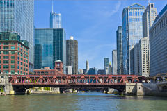 Bridge and Buildings, Chicago River, Illinois. A bridge crosses the Chicago River in the downtown Chicago business district, with buildings lining each side of Stock Image