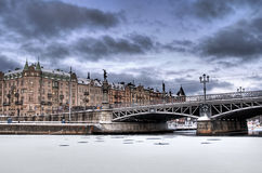 Bridge and buildings in winter. Royalty Free Stock Image