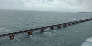bridge builted in sea stock photos