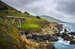 Bridge on California Highway 1 Land and Sea Image. Bridge along cliffs on California Highway 1 land and seascape stock images