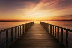 Bridge on calm sea at twilight time Royalty Free Stock Photos