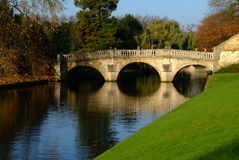 Bridge in cambridge. Bridge over water with green hill in front Royalty Free Stock Image