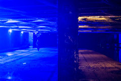Bridge in Camden with blue light to put off drug users. Under a railway bridge over the Regent's Canal passing through Camden in North London.  The blue light is Royalty Free Stock Images