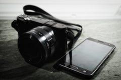 Bridge Camera Beside Samsung Smartphone Stock Photos